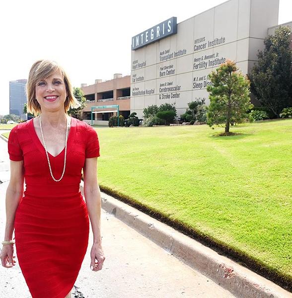 Dr. Mary Ann Bauman walks in front of Integris Baptist Medical Centerc 3300 N.W. Expressway, 9-30-15. - MARK HANCOCK