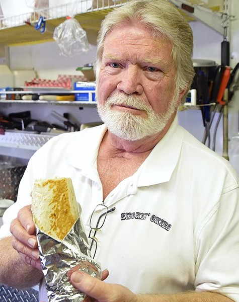 Smokin' Okies owner Larry Starns with the Pulled Pork BBQ burrio, out on location in he and his wife/co-owner Nancy's food truck.  mh