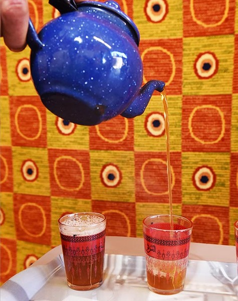 Pouring glasses of Moroccan hot mint tea at Argan Cafe, 2908 NW 23rd Street, OKC, 12-10-15. - MARK HANCOCK