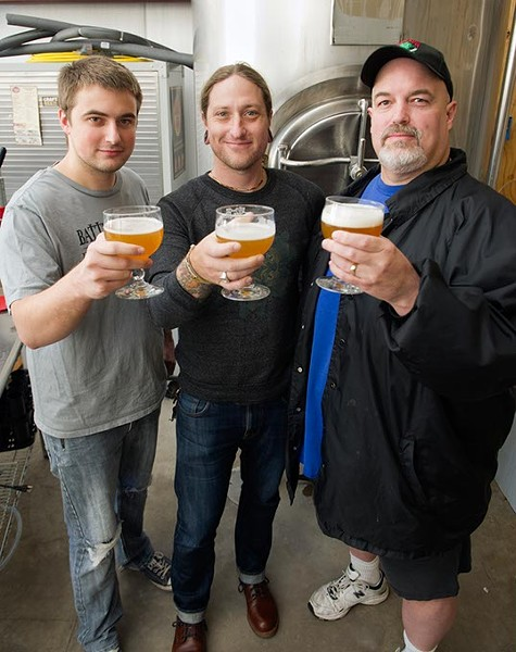 Jordan Sandefur, Chris Gaylor, and Mike Sandefur toast to a great brew at Battered Boar Brewery in Edmond, OKla. Chris Gaylor, the drummer for The All American Rejects, is the brewery's investor. Photo by Lauren Hamilton - LAUREN HAMILTON