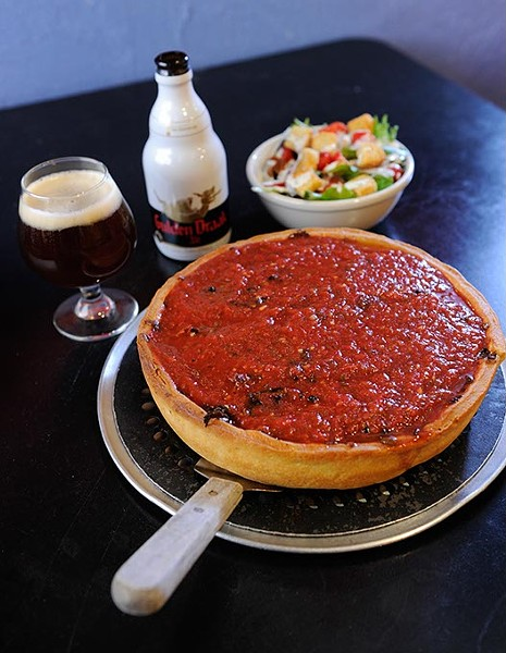 "10"" Supreme Chicago-style deep dish pizza with a half spinach salad and beer at Humble Pie in Edmond, Tuesday, Jan. 14, 2015. - GARETT FISBECK"
