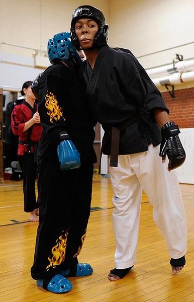 Nieko Ligons, 17, hugs Sierra Carter, 16, after sparring at Harding Fine Arts Academy in Oklahoma City, Wednesday, Jan. 21, 2015. - GARETT FISBECK