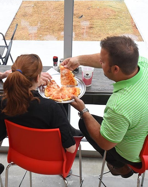 Patrons at the downtown location for Revolve Pizza Kitchen can sit in the window and watch the downtown world go by, 7-21-2015.  File - MARK HANCOCK