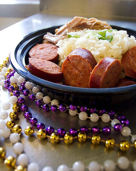 """Red Beans and Rice with """"pernil"""" Pork(puerto rican style) and  smoked sausage framed with mardi gras beads at La Gumbo Ya-Ya food truck in Oklahoma City, Saturday, July 25, 2015. - KEATON DRAPER"""