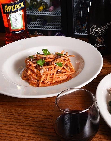 Bucatini Amatriciana pasta, with Pinnacoli red wine and other drinks, at Patrono, 11-10-15. - MARK HANCOCK