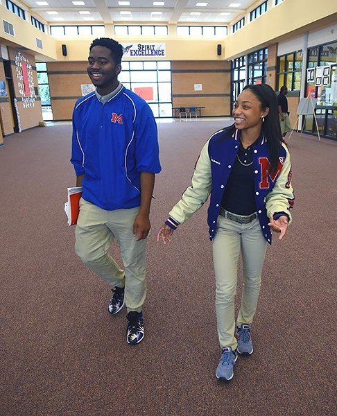 From left, Sr. Class President E.J. Green walks with full scholarship receipient, Breonna Hall, at Millwood High School, 10-5-15. - MARK HANCOCK