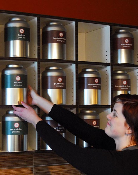 Kasey Best reaches for a canister of tea at t, an Urban Tea House.  file photo mh