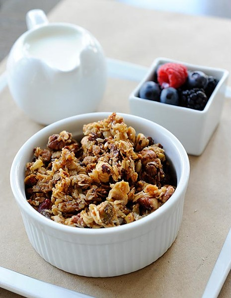 House made granola with berries and milk at Kitchen 324 in Oklahoma City, Thursday, Sept. 17, 2015. - GARETT FISBECK