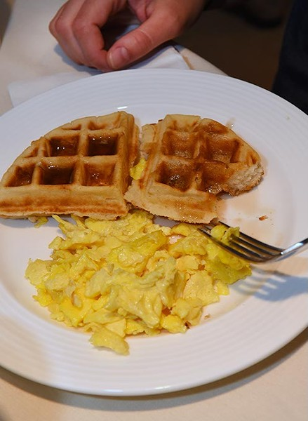 A plate of eggs and waffles during the Stella Artois Waffles and Beer Filmmaker Brunch at the OKCMOA, Friday morning, day 2 of the DeadCenter Film Festival. - MARK HANCOCK