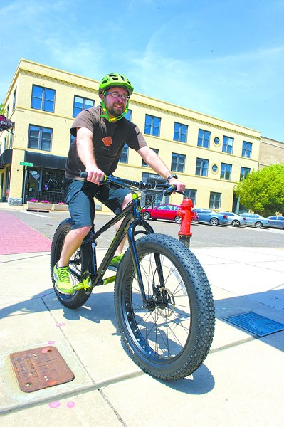 Steve Swanson outside of Schlegel Bicycles - Photo by Shannon Cornman - SHANNON CORNMAN