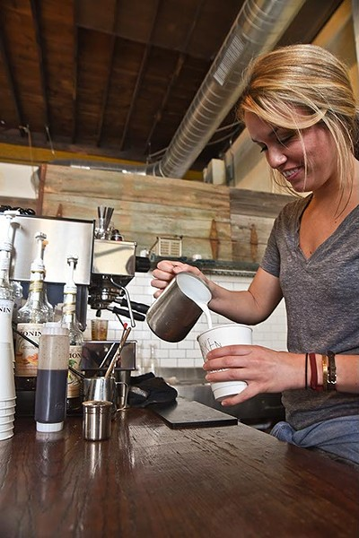 Barista Savannah Crockett makes a latte recently at the Hoboken Coffee Roasters in Guthrie.  mh