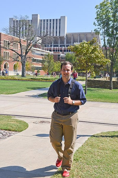 Dillon Hollingsworth, sports editor at the Oklahoma Daily, heads back to the newsroom from the weekly news conference with coach Bob Stoops across the University of Oklahoma campus, 9-28-15. - MARK HANCOCK