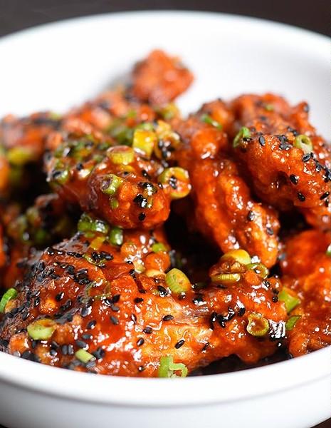 Gochujang wings for Paul Langer's new concept Chicken & Beer, Tuesday, May 17, 2016. - GARETT FISBECK