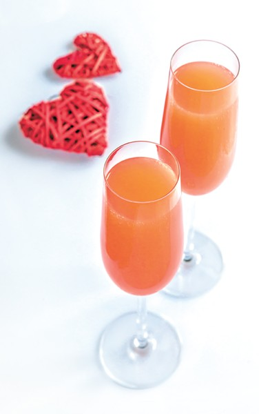 Two bellini cocktails with hearts on the white background - BIGSTOCK