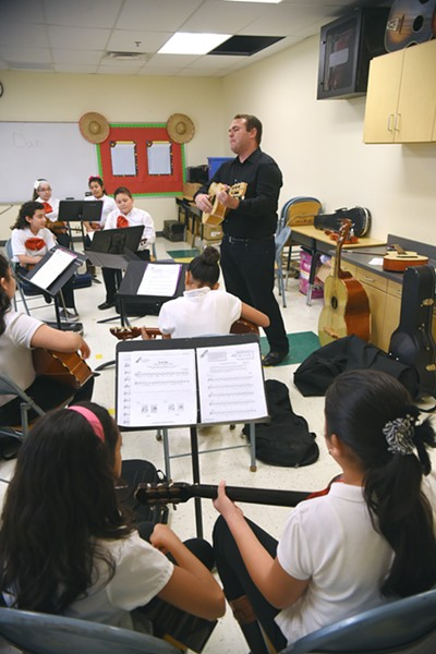 Mariachi students led by Christiaan Osborn in his class at Filmore Elementary School in South Oklahoma City, 1-15-16. - MARK HANCOCK