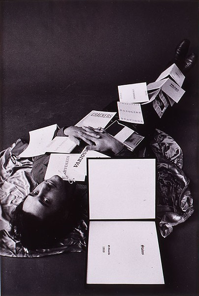 """Ed Ruscha Covered with Twelve of his Books"" by Jerry McMillan (Image Fred Jones Jr. Museum of Art / provided)"