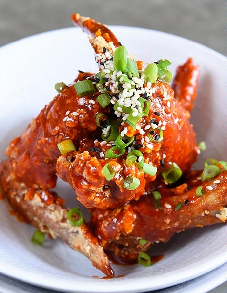 Chicken Wings in spicy sauce at Chae Modern Korean, Wednesday, May 11, 2016. - GARETT FISBECK