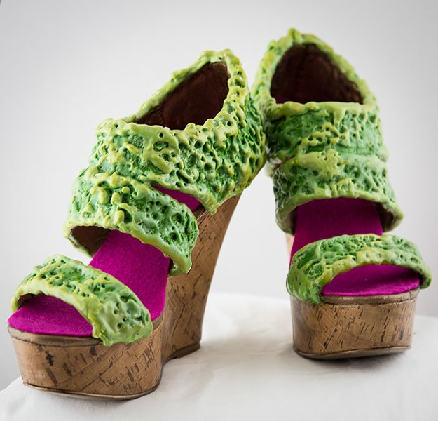 """Repurposed thrift-store stilettos become part of Gayle Curry's brightly-hued """"Walking in Their Shoes"""" installation at Science Museum Oklahoma's Sole Expression: The Art of the Shoe exhibit. (Photo provided)"""