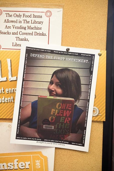 Fliers around the Oklahoma City Community College campus show staff posing with their favorite banned books. (Garett Fisbeck)