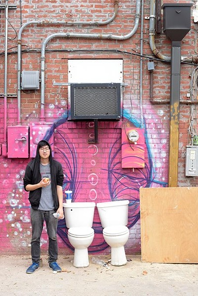 Local comedian James Nghiem's tribute to Banksy is the latest in his series of pop culture-themed art shows. | Photo Garett Fisbeck