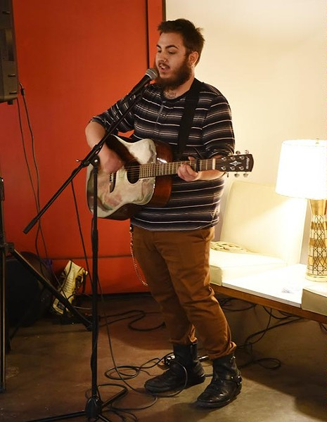 Parker Cunningham, at District House in the Plaza District, where he performed songs while his mother, author Sarah Cunningham did a reading and book signing event, 1-27-15.  mh