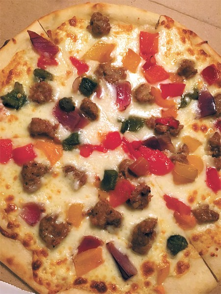 The sausage and pepper pizza is one of two on the menu that is served without sauce. | Photo Jacob Threadgill