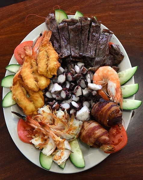 "The Mar y Tierra, ""land and sea"" dish, with octopus in the center, surrounded by creatures from both land and sea, including shrimp wraped with bacon, at Mariscos Mazatlan on South Robinson Avenue in Oklahoma City, 1-27-16. - MARK HANCOCK"