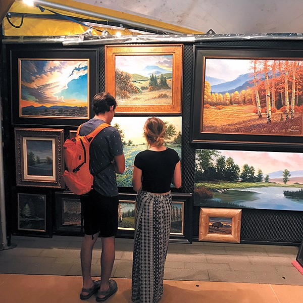 Guests peruse art at a recent Festival of the Arts - in Oklahoma City. - PROVIDED