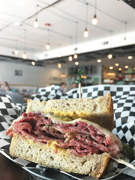 The New York, NY is the most popular sandwich at Scottie's Deli, pairing pastrami with corned beef. - JACOB THREADGILL