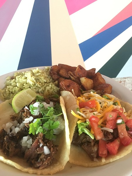 Street- and Tex-Mex-style tacos are joined by green rice and roasted potatoes. - JACOB THREADGILL