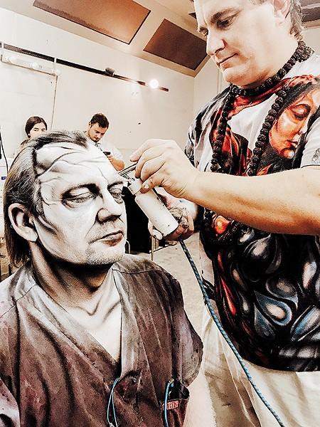 Jim Baughman sits for makeup at The Sanctuary. - JO LIGHT