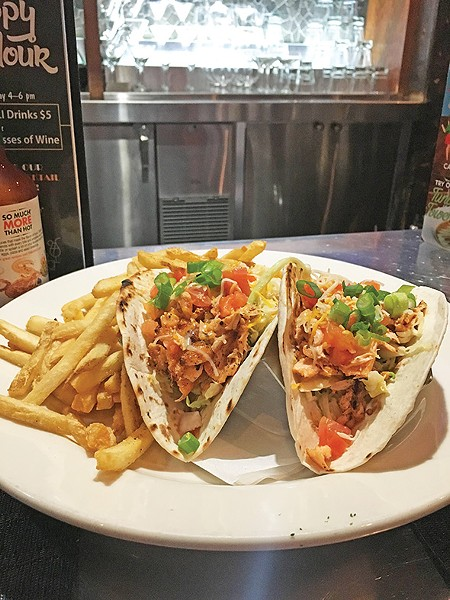 A lunch portion of salmon tacos with fries at Pearl's Oyster Bar - JACOB THREADGILL