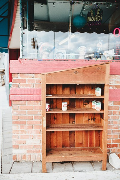 Plaza District community members refill Pine Pantry in front of Bad Granny's - Bazaar almost nightly. - ALEXA ACE