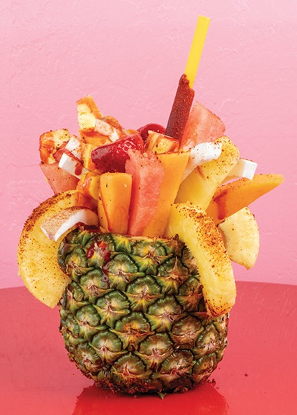 A piña loca covered in lime juice and chamoy seasoning - SYN3RGY GREATIVE GROUP / PROVIDED