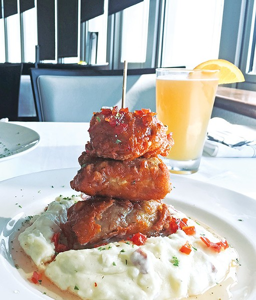 Confit fried chicken thighs finished in tomato jam are a new menu addition at 3Sixty Restaurant & Bar. - JACOB THREADGILL