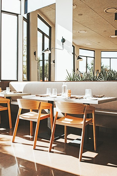 Frida Southwest's main dining room features modern Southwestern decor. - ALEXA ACE