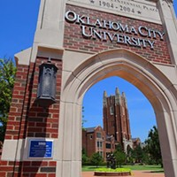 Looking under the Centinnial Plaza arch on the southeast corner of the OCU campus.  mh