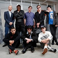 Steven Battles poses for a photo with his crew at SIG Art Gallery in Oklahoma City, Friday, May 15, 2015.