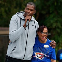 Kevin Durant hugs Principal Anita Jones during a Kevin Durant Charity Foundation unveiling of a basketball court at North Highland Elementary School in Oklahoma City, Monday, Oct. 5, 2015.