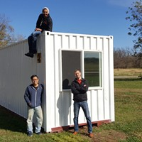 Clockwise from lower left, Ben Loh, Swapneel Deshpande, and Lee Easton, with the prototype ModernBlox container home in Stillwater.