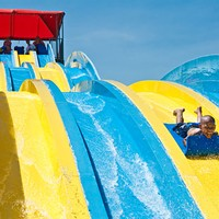 A boy races down the big slide at Andy Alligator's Water Park.
