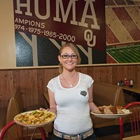 Waitress Heather Azbell with a California Omelette, left, and a Meat Loaf, Green Beans and Mashed Potatoes plate, at Hassler's Restaurant in Norman.