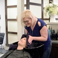 Malisa Osborne washes Theresa Pham hair at Van Cleefs Salon, Wednesday, Feb. 22, 2017.