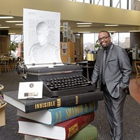 Michael Owens poses for a photo at the Ralph Ellison Library, Monday, Feb. 13, 2017.