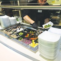 Guests choose which vegetables and protein to pair with either rice or noodles at the Asian bowl station in Nebu.