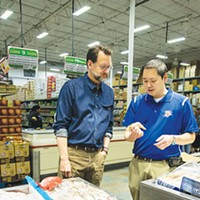 Ba Luong tells chef Kurt Fleischfresser about the latest shipment of tiger prawns.