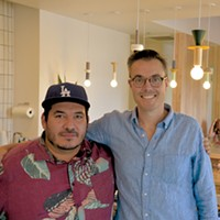 Commonplace co-owners Chris Castro and Ben Nockels inside the new kitchen. Castro is the head chef and menu planner.