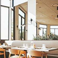 Frida Southwest's main dining room features modern Southwestern decor.