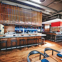 Gun Izakaya features an alcohol bar complete with the state's first highball machine and a bar with a yakitori grill.