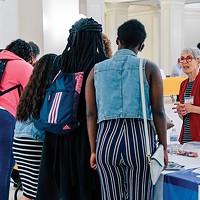 League of Women Voter's Rebecca Greenhaw signs students up for Civics Day, Generation Citizen's end-of-semester event during which students present their action plans to public officials and community members.